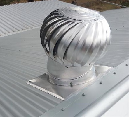 Whirly bird installed onto a new metal roof