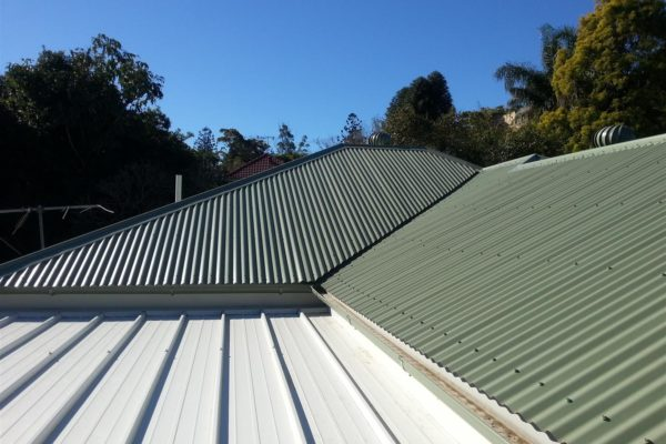 Main roof is corrugated and front extension is insulated panel roof