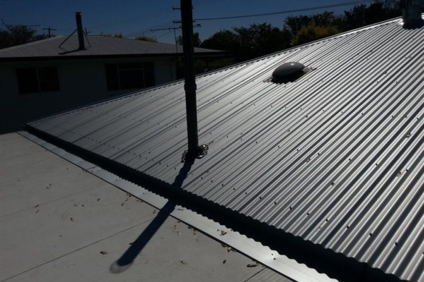 This property had a new roof, skylight, vent pipe and whirly bird installed