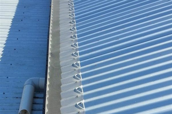 Completed gutterguard job installed onto corrugated roof.