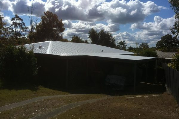 Back of property - metal roof painting. At this property we replaced some damaged roof sheets as well.