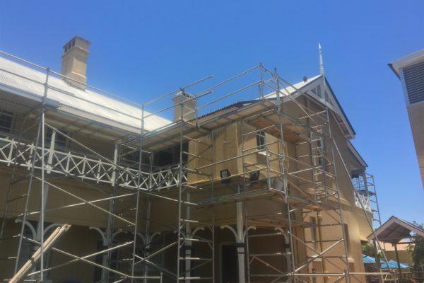 Reguttering works in progress using scaffold (1 of 2)